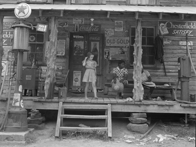 Dorothea Lange Photo. Person County, NC. July 1936.       daughter-of-white-tobacco-sharecropper-at-country-store-person-county-north-carolina-ju39.