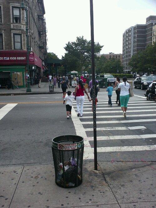Lenox Avenue (looking south) at 116th Street. Harlem, New York City.