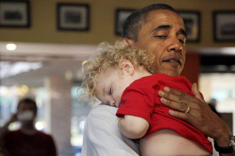 a-sleepy-young-iowan-rests-his-head-on-the-presidents-shoulder