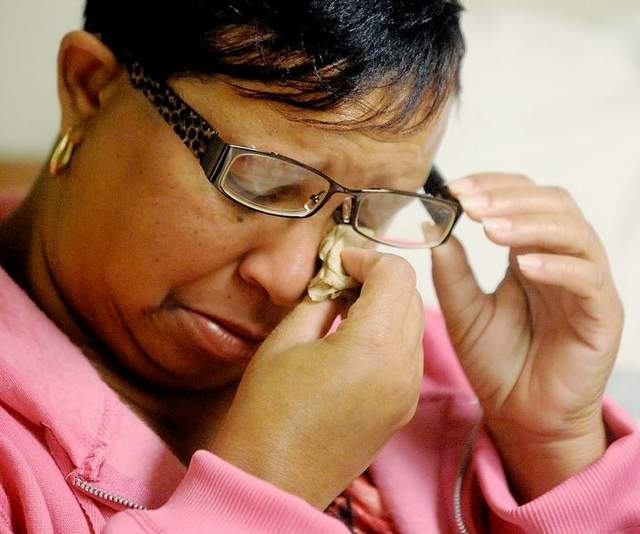 Image: Edna Moffitt, the mother of burn victim Sharmeka Moffitt, wipes away tears